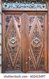 Exquisite ancient door with silver knockers in Granada, Spain