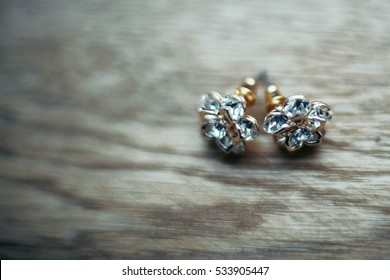 exquisite elegant expensive gold earring with a pattern of flowers
