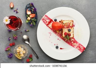 Exquisite restaurant dessert. Caramel milfuelle with spicy pear, berry sauce and almond flakes on white plate finely decorated with candy spiral. Exclusive meals and haute cuisine concept, top view