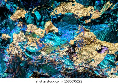 Exteme macro with 10x magnification of a Bornite surface. Bornite, also called Peacock ore, is a sulfide mineral