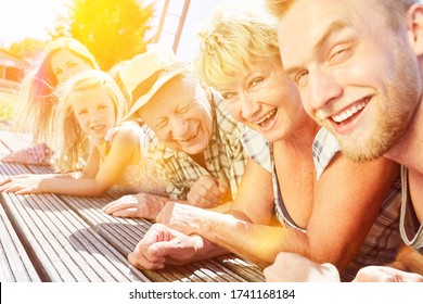 Extended family with children and grandparents together on summer vacation