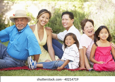 Extended Family Group Relaxing In Garden