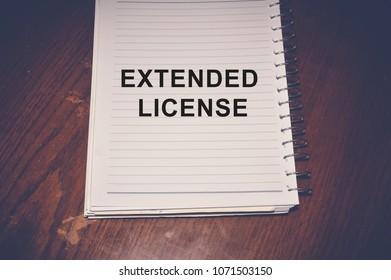Extended license word written on white paper