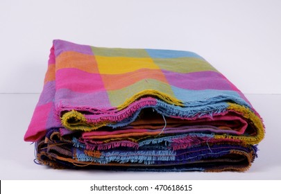 Extended Mexican pink blue zarape fabric extended line fabric line colors pink mexican yellow purple orange folded cotton fabric white background