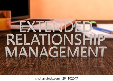 Extended Relationship Management - letters on wooden desk with laptop computer and a notebook. 3d render illustration.