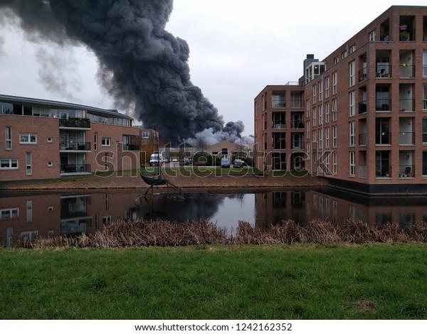 An extensive fire destroys a large building in a residential area. Karwei construction market. APELDOORN, THE NETHERLANDS - 27 NOVEMBER 2018