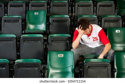 Extensive series of a crowd of baseball fans, sitting in a stadium.  Having fun, cheering, etc.