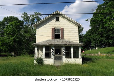 Exterior of an abandoned and neglected house.