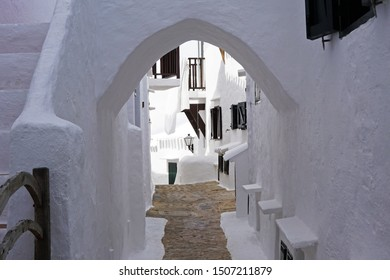 Exterior architecture and building design of The quaint old fishing village of Binibeca Vell (Binibèquer Vell) white houses form a small labyrinth of narrow, cobbled corridors- Menorca, Spain