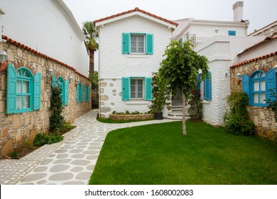 Exterior of authentic houses and colorful wooden shutters in Sigacik village, Izmir city, Turkey.
