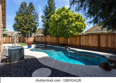Exterior Backyard with Pool and Hot Tub in a neighborhood