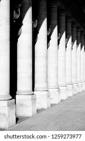 Exterior of a building with pillar column black and white