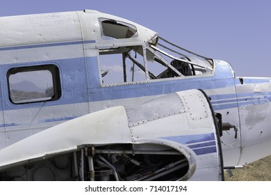Exterior of a cockpit on an abandoned silver airplane with missi