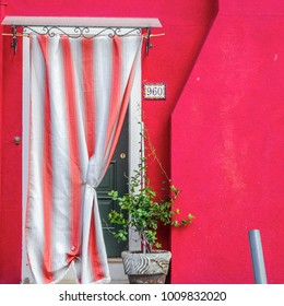 Exterior of colorful houses of Burano Island in Venice.