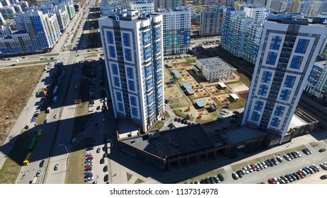 Exterior day time establishing shot of generic urban city brick apartment building high rise affordable housing complex. skyline city view of modern metropolis.