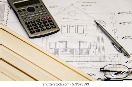 exterior design of new home renovation with kitchen cabinet door, calculator and pencil.
