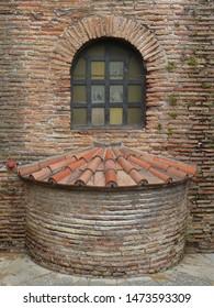 Exterior detail of semicircular tiled roof, Basilica of San Vital (Byzantine, 6th century). City of Ravenna. Italy