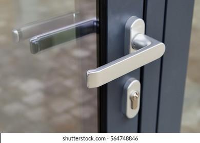 Exterior door handle and Security lock on Metal frame - Low deep of field