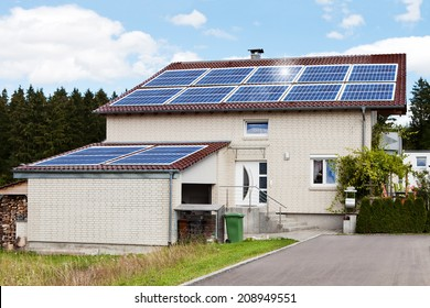 Exterior of dream house with solar panels on roof