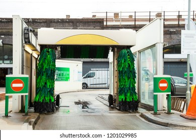 The exterior of empty Automatic car wash machine station.