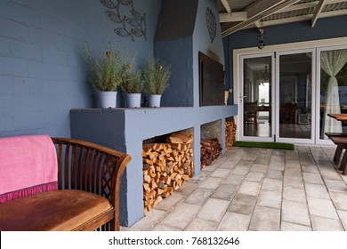 Exterior Of An Entertainment Area In The Backyard Of A Contemporary Suburban  House With A Barbecue