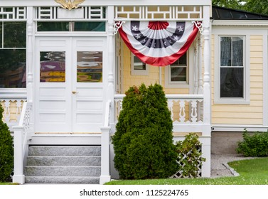 Exterior and Front Door of a Beautiful Old House with banting flag in New Hampshire, USA