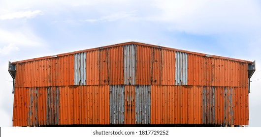 exterior godown building with rusty zing wall on blue skyin landscape concept