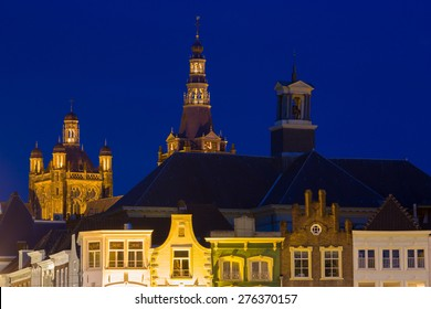 Exterior of the gothic medieval cathedral of Saint John, at night with old houses in front, one of the top attractions of Den Bosch, 's-Hertogenbosch, Netherlands