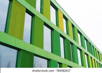 exterior of a green facade of a modern office building