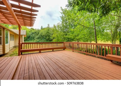 Exterior of horse ranch with empty wooden walkout deck.  Northwest, USA