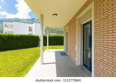 Exterior of house with green garden during a sunny day. Nobody inside