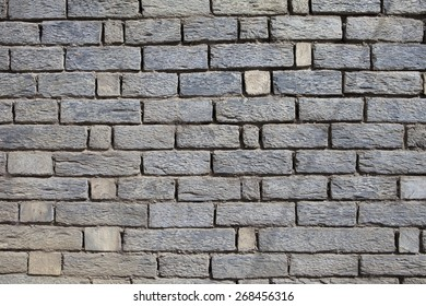 Exterior of a house in the himalayas. Rocks cut in shape of bricks as facade.