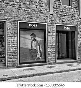 Exterior of Hugo BOSS luxury store in Florence. The fashion brand has made the history of elegance for men and women. Black and White Photo. Shopping in Italy. Florence – April 17, 2018