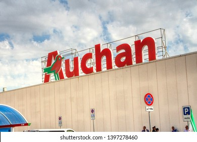 Exterior of an Italian Auchan hypermarket. In May 2019, French group Auchan Retail sells its Italian subsidiary to Conad. Puglia, Italy - 14/05/2019