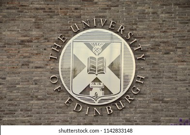 The exterior and logo for the University of Edinburgh. Silver disc with St Andrews cross. Genetics Institute, Crewe Road South Edinburgh. Scotland. UK. July 2018