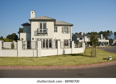 Exterior of a luxury house on a sunny day
