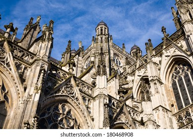 Exterior with many gothic details against a deep blue sky of the gothic medieval cathedral of Saint John, one of the top attractions of Den Bosch, 's-Hertogenbosch, Netherlands