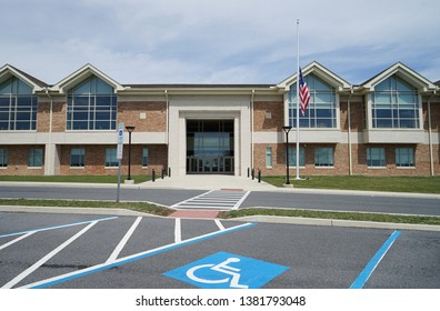 Exterior of a modern American school.   The school is two story and there is an American flag on the flagpole.  This is Northampton Area Middle School in Northampton, Pennsylvania.