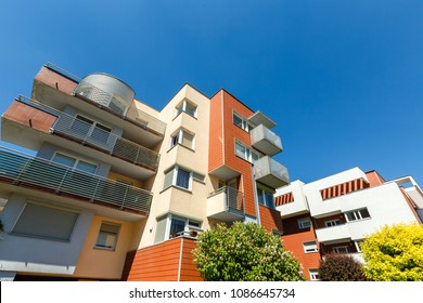 Exterior of a modern  apartment buildings on a blue sky background. No people.  Real estate business concept. Wide angle.