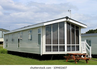 Exterior of modern caravan, trailer or mobile home in park - generic one available for hire.