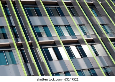 Exterior of modern corporate high rise skyscraper with glass and steel reflective surface.
