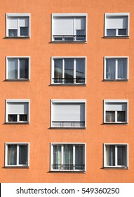 Exterior of modern light orange or ocher urban housing block with apartments