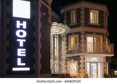 Exterior of a modern and new luxury hotel, night scene.