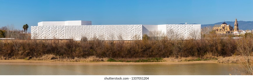 Exterior of modern white Contemporary creation center building placed on embankment of Cordoba city, above Guadalquivir river in Andalusia, Spain