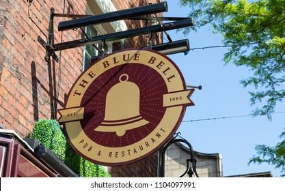An exterior mounted pub sign for the pub and restaurant The Blue Bell in Warrington Cheshire May 2018