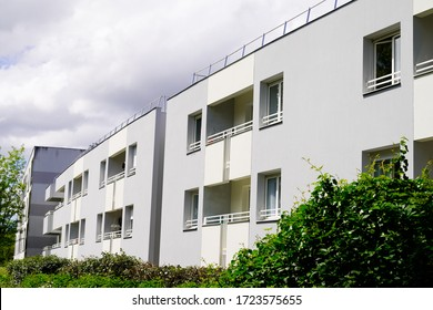 Exterior of new white modern architecture residential building in street