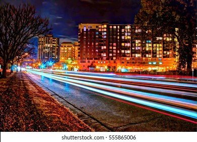 Exterior nighttime long exposure HDR stock photo of traffic along Lake Drive bordering Lake Calhoun in Uptown in Minneapolis, Minnesota