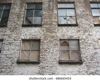 Exterior of old building. Old building with broken windows