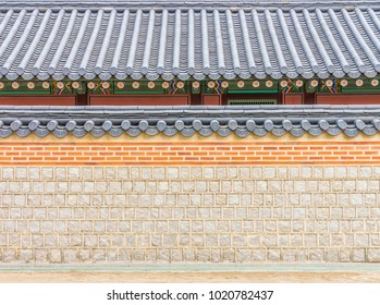Exterior of old Korean wall and roof. They are in Gyeongbokgung Palace, South Korea.