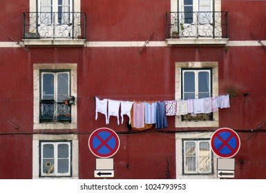 An exterior of the old Lisbon house with the linen drying outside the building